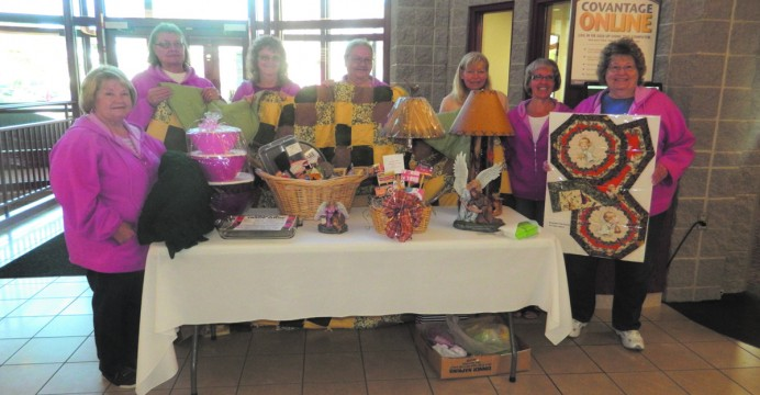 Members of the Antigo Junior Woman's Club with raffle prizes for their annual Craft and Trade Show. Pictured left to right: Betty Cross, Kathy Boksa, Melody Koles, Bobbi Susalla, Therese Fermanich, Peg Andres, Janice Jorgensen.